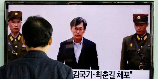 A South Korean man watches a TV screen reporting about South Korean Kim Kuk Gi, center, detained in North Korea, at the Seoul