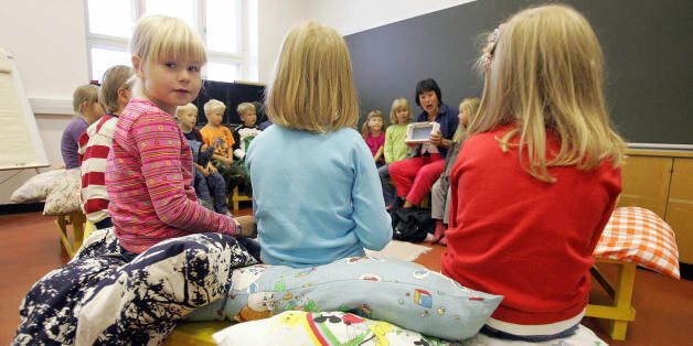 (FILES) This file picture dated 17 August 2005 shows children listening to their teacher in a primary school in Vaasa, on the