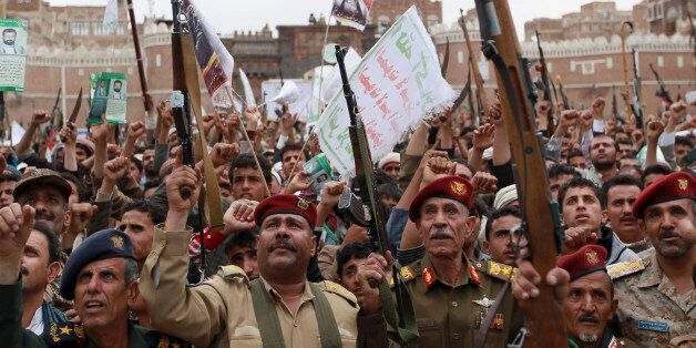 Shiite rebels, known as Houthis, hold up their weapons to protest against Saudi-led airstrikes, during a rally in Sanaa, Yeme