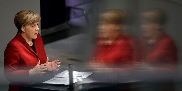 German Chancellor Angela Merkel gestures during her speech as part of a meeting of the German federal parliament, Bundestag,