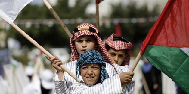 Palestinian children take part in an activity organised to mark Land Day on March 30, 2015 in Gaza City. The annual Land Day