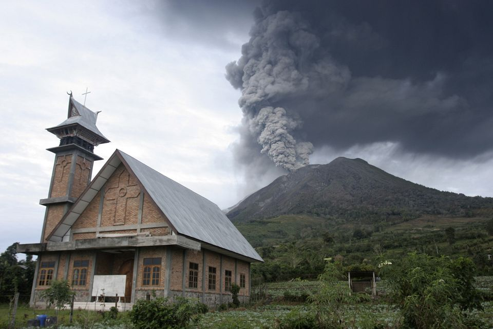 Mount Sinabung spews volcanic materials into the sky in Karo, North Sumatra.
