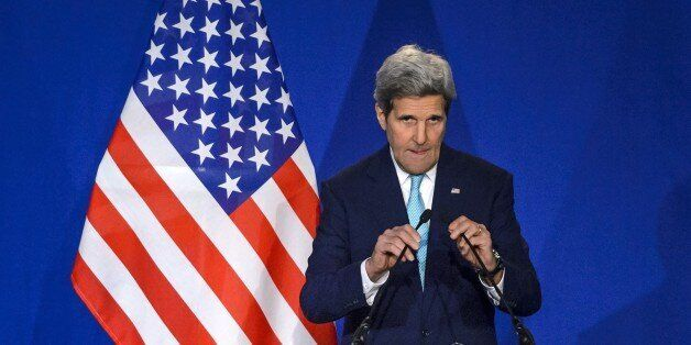 US Secretary of State John Kerry arrives at the podium during a press conference at the Swiss Federal Institute of Technology