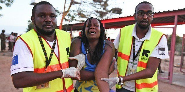 Paramedics help a student who was injured during an attack by Somalia's Al-Qaeda-linked Shebab gunmen on the Moi University c
