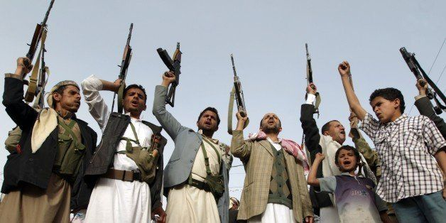 Supporters of the Shiite Huthi militia brandish their weapons in the Yemeni capital Sanaa on April 5, 2015, during a demonstr