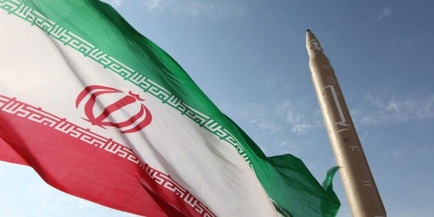 A picture taken on August 20, 2010 shows an Iranian flag fluttering at an undisclosed location in the Islamic republic next t