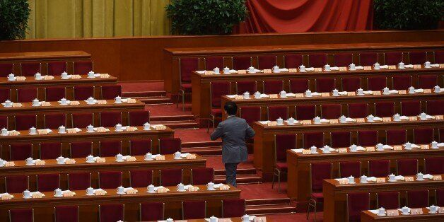 A delegate arrives for the closing ceremony of the Chinese People's Political Consultative Conference, an advisory body to th