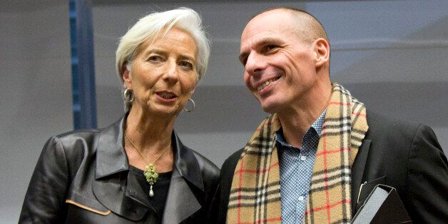 Managing Director of the International Monetary Fund Christine Lagarde, left, shakes hands with Greek Finance Minister Yanis