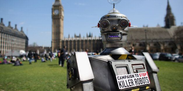 LONDON, ENGLAND - APRIL 23:  A robot distributes promotional literature calling for a ban on fully autonomous weapons in Parl