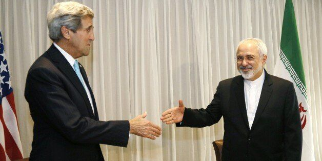 Iranian Foreign Minister Mohammad Javad Zarif shakes hands on January 14, 2015 with US State Secretary John Kerry in Geneva.
