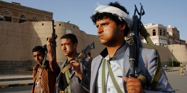 FILE - In this Wednesday, April 1, 2015 file photo, Shiite rebels, known as Houthis, carry their weapons as they march to pro