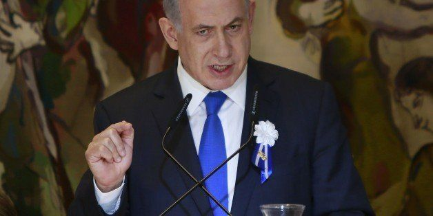 Israeli Prime Minister Benjamin Netanyahu gestures as he delivers a speech during an event following the first session of the