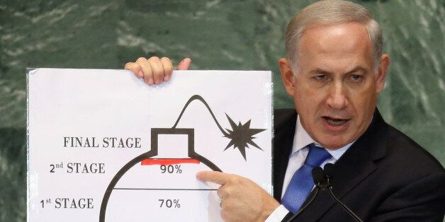 NEW YORK, NY - SEPTEMBER 27:  Benjamin Netanyahu, Prime Minister of Israel, points to a red line he drew on a graphic of a bo