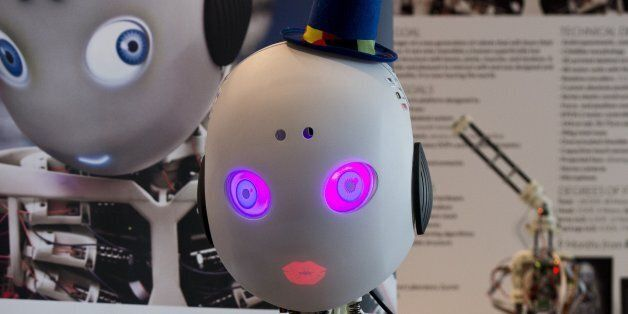 Roboy, a humanoid robot developed at the Artificial Intelligence Laboratory of the University of Zurich, mimics a kiss, at th