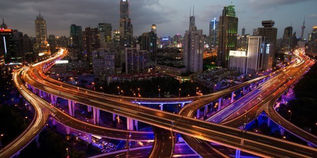This long exposure picture shows vehicles on roads during rush hour on the eve of the National Day holidays in Shanghai on Se