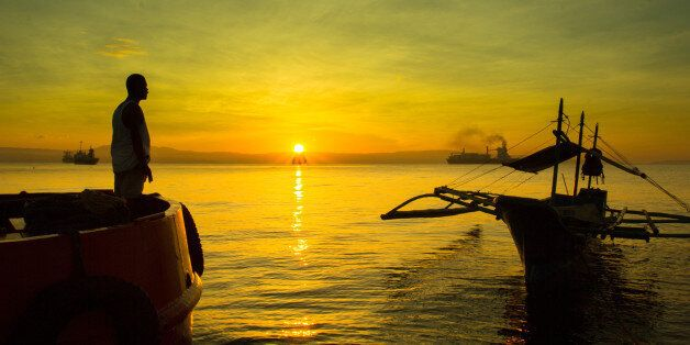 """Went to Sta. Ana Pier, Davao, Philippines to chase the sunrise. January 13, 2013.  """"It's important in life to conclude th"""