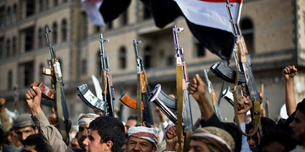 FILE - In this Friday, April 10, 2015 file photo, Shiite rebels, known as Houthis, hold up their weapons as they attend a pro