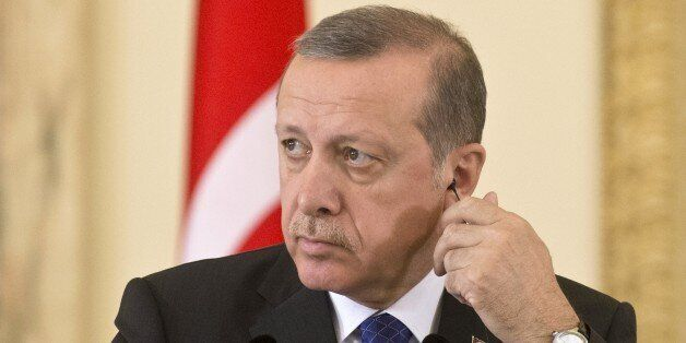 Turkish President Recep Tayyip Erdogan attends a news conference during a meeting with Romania's President at the Cotroceni P