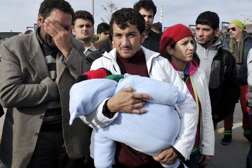 Migrants who survived an incident near the island of Farmakonisi arrive at the harbor of Piraeus, Greece, on Jan. 23, 2014.