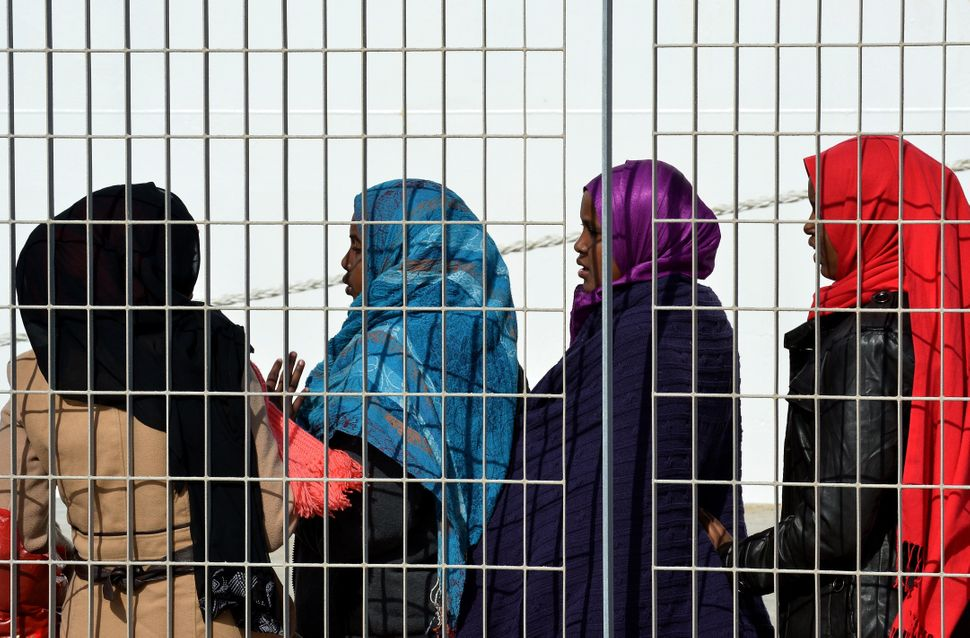 Women wait at the port of Lampedusa to board a ferry bound for Porto Empedocle in Sicily on Feb. 20, 2015.