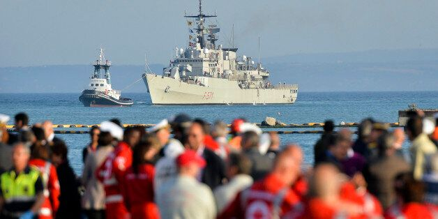 """FILE - In this Tuesday, May 13, 2014 file photo, the Italian Navy frigate """"Grecale"""", carrying victims and survivors of a migr"""