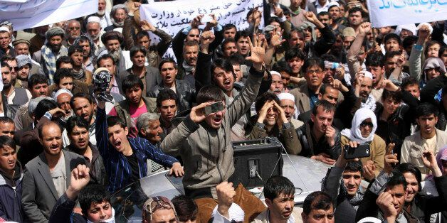 Hundreds of businessmen, shop owners and traders protest against tax hikes in Kabul, Afghanistan, Monday, April, 6, 2015. Afg