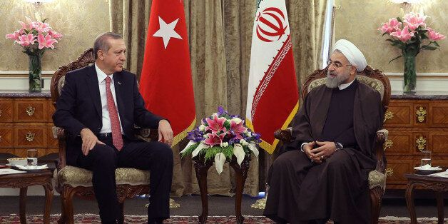 Iran's President Hassan Rouhani meets with Turkish President Recep Tayyip Erdogan during an official welcoming ceremony follo
