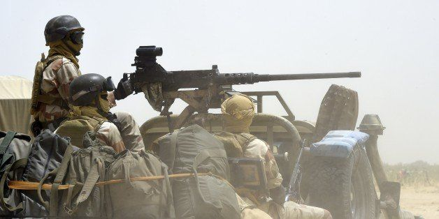 Nigerien army forces patrol in pickup trucks near Malam Fatori on April 3, 2015, after the town in north-eastern Nigeria was