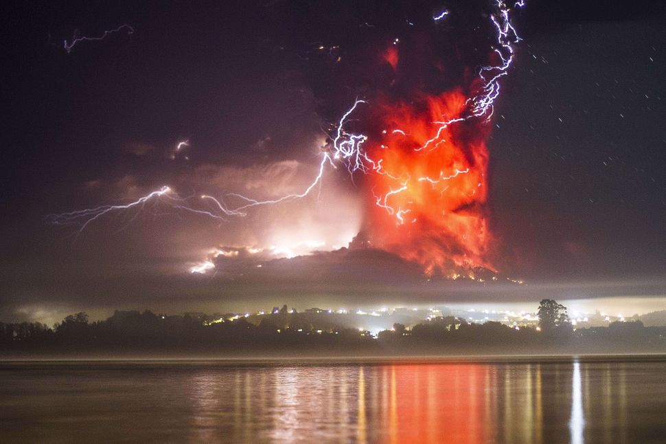 This view from Puerto Varas, southern Chile, shows a high column of ash and lava spewing from the Calbuco volcano, on April 2