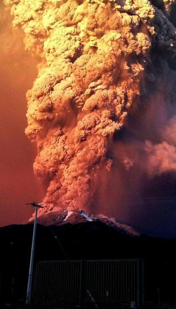 View from Puerto Varas, southern Chile, of a high column of ash and lava spewing from the Calbuco volcano, on April 22, 2015.