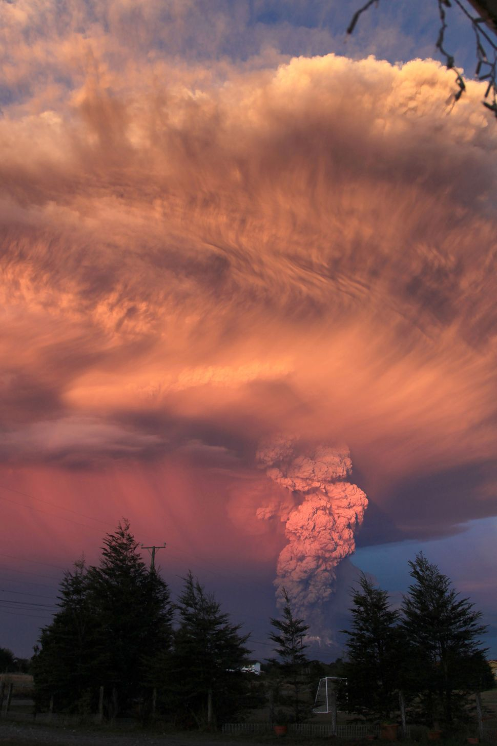View from Puerto Montt, southern Chile, of a high column of ash and lava spewing from the Calbuco volcano, on April 22, 2015.