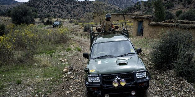In this Thursday, March 28, 2013 photo, Pakistan army soldiers patrol Sararogha, which was the stronghold of the Taliban in S
