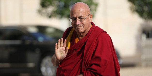 French Buddhist monk Matthieu Ricard arrives on September 21, 2013 at the Elysee presidential Palace in Paris. AFP PHOTO / KE