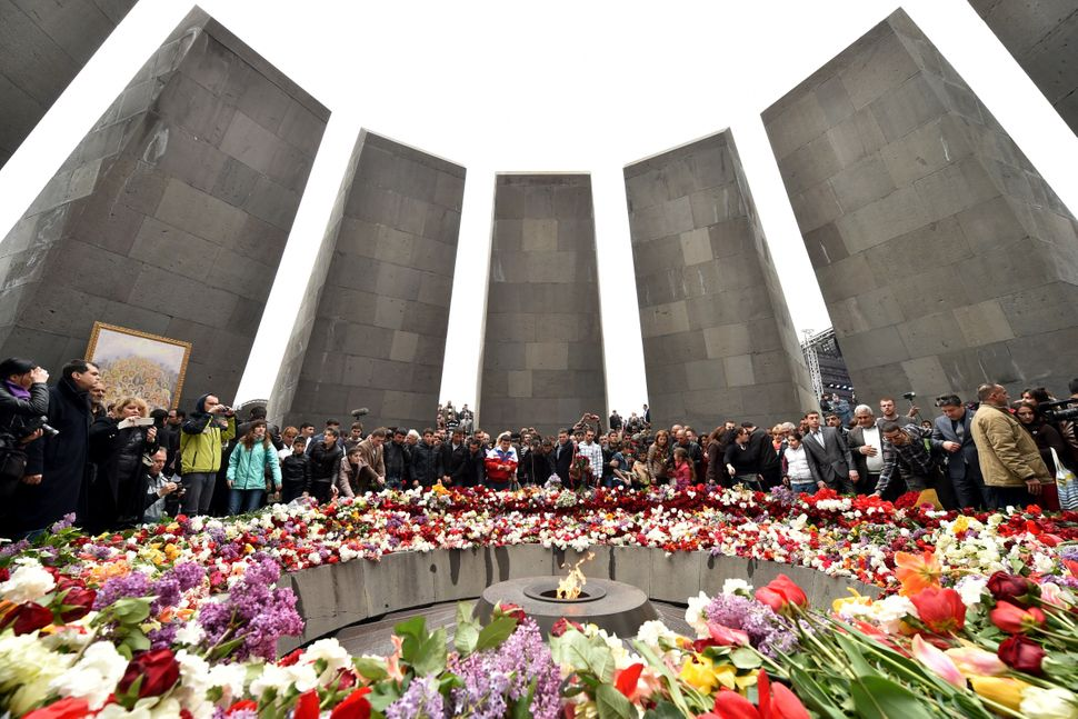 People lay flowers at the Tsitsernakaberd Memorial, on April 24, 2015, in Yerevan, as part of the Armenian genocide centenary