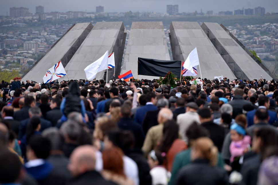 People wait to lay flowers at the Tsitsernakaberd Memorial, on April 24, 2015, in Yerevan.