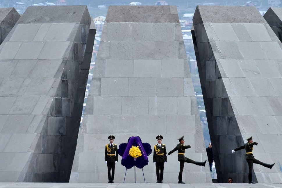 Armenian honor guard soldiers lay a wreath at the Tsitsernakaberd Memorial in Yerevan on April 24, 2015.