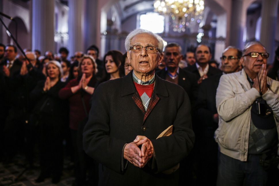 A man prays during a commemoration service for the 1915 massacre of Armenians at the Armenian Patriarchate in Istanbul on Apr