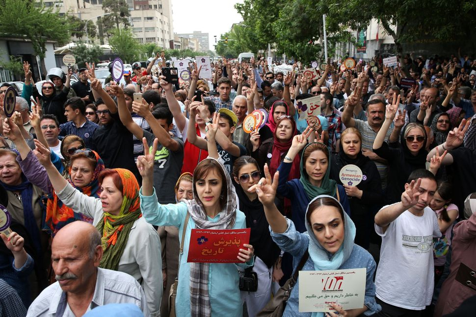 Iranian Armenians protest near the Turkish embassy in Tehran to mark the 100th anniversary of the Armenian genocide in Tehran