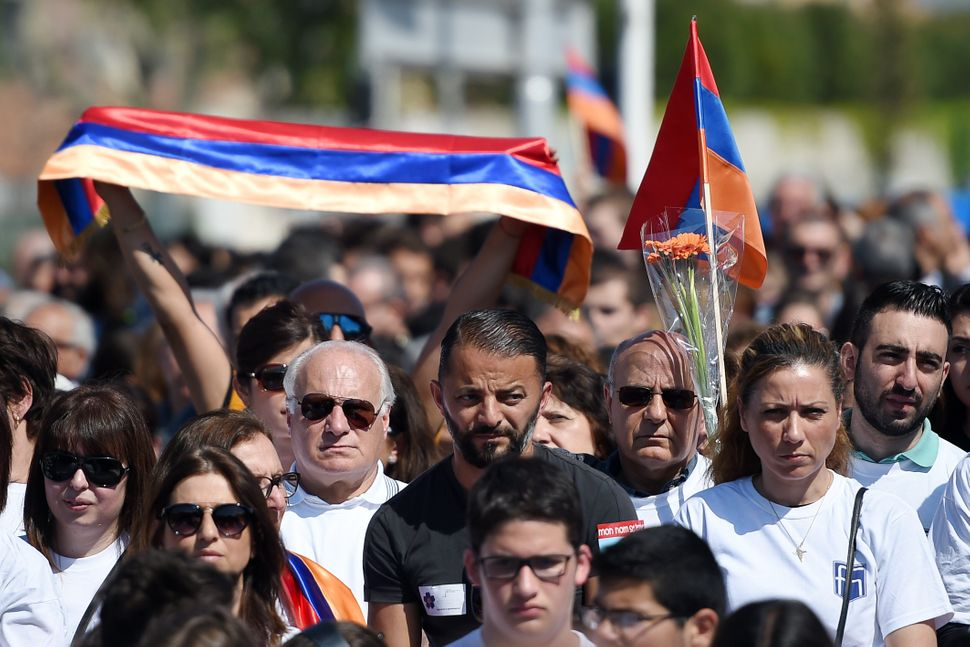 People gather to pay their respects during a ceremony at the Memorial of the Armenian Genocide in Marseille, France, on April