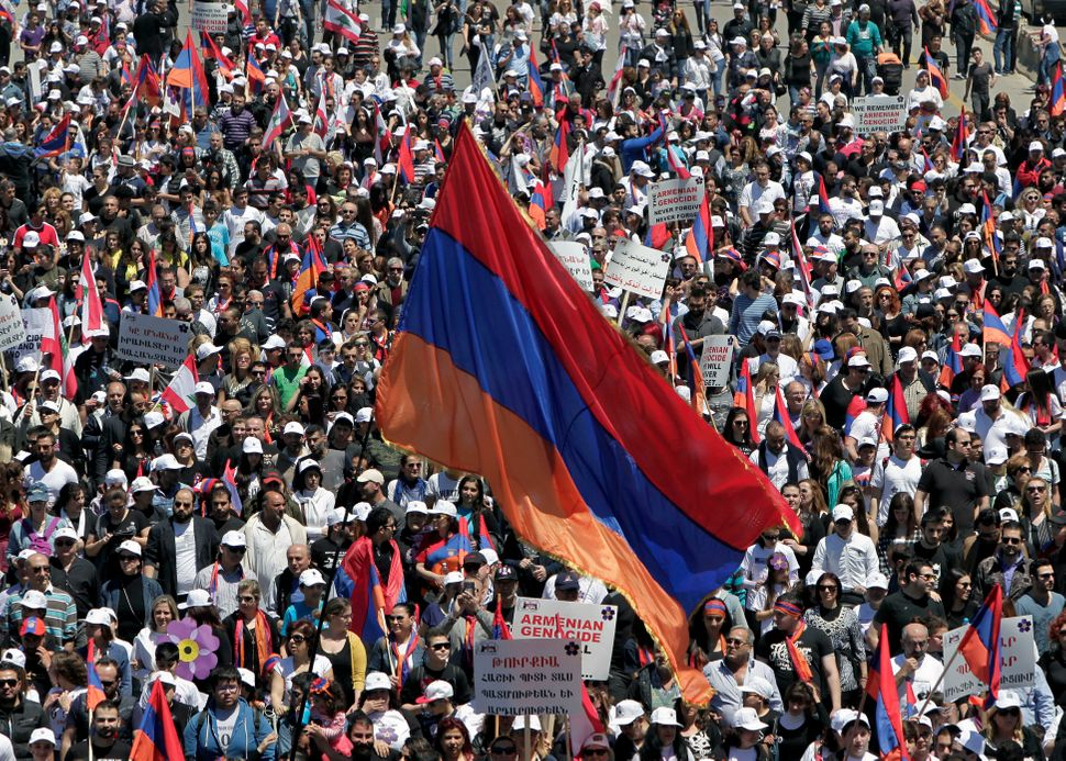 Armenians in Lebanon march to mark the 100th anniversary of the mass killings during World War I, in Antelias, north of Beiru