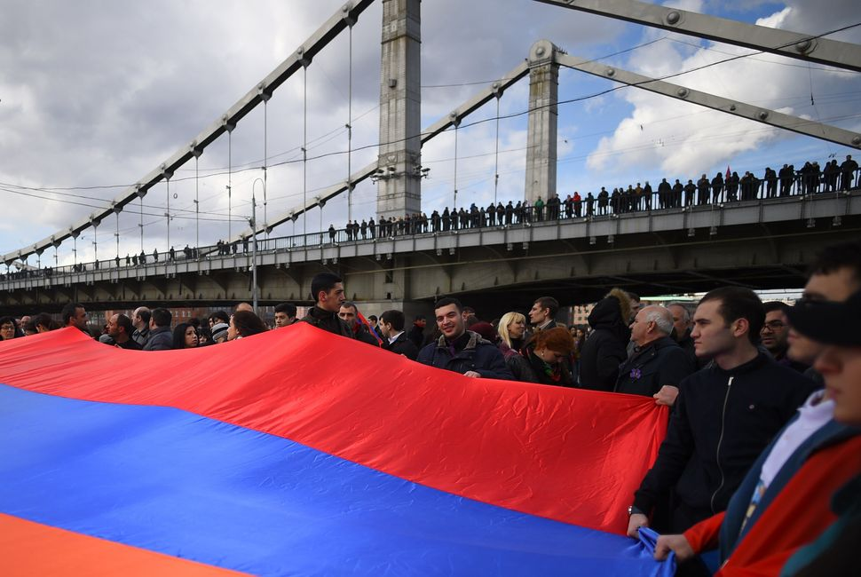 People holding a giant Armenian flag gather in central Moscow on April 24, 2015, to mark the 100th anniversary of the Armenia