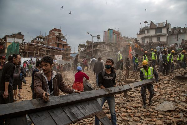 Emergency rescue workers clear debris in Basantapur Durbar Square while searching for survivors on April 25, 2015, in Kathman