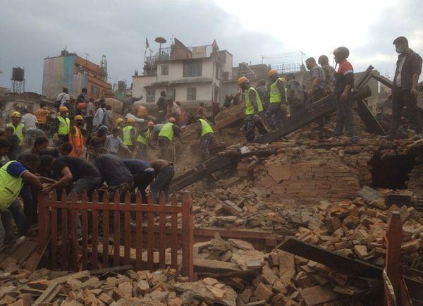 Rescuers clear the debris at Durbar Square. (AP Photo/ Niranjan Shrestha)
