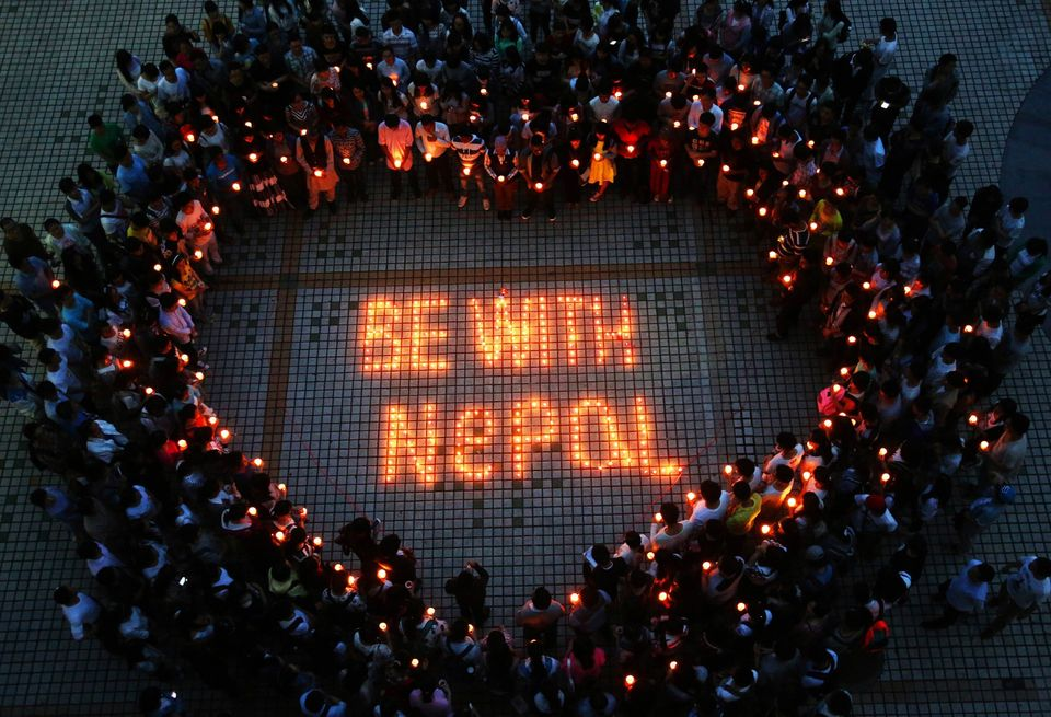This picture taken on April 26, 2015 shows Nepalese students and Chinese students gathering to pray for Nepal in Nanhua Unive