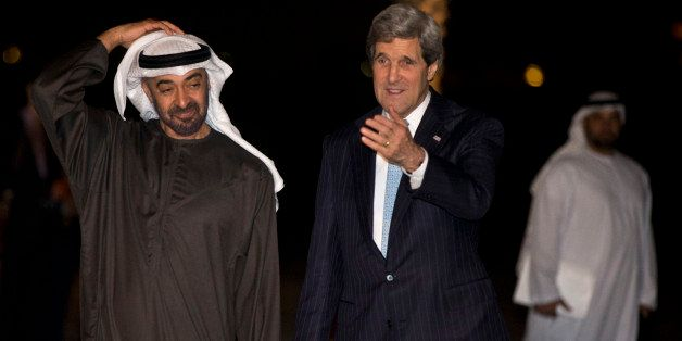 Abu Dhabi Crown Prince Sheik Mohammed bin Zayed al Nahyan, left, walks with U.S. Secretary of State John Kerry to pose with h