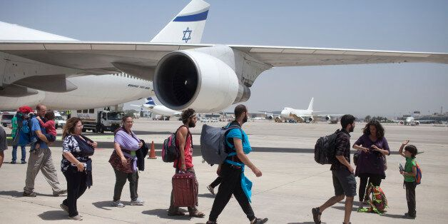 TEL AVIV, ISRAEL - APRIL 28:  Israeli travelers with their new born babies from surrogate mothers in Nepal disembark from an