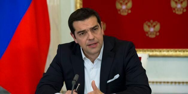 Greek Prime Minister Alexis Tsipras speaks at a joint news conference with Russian President Vladimir Putin after a signing c