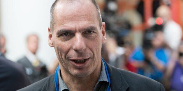 Greek Finance Minister Yanis Varoufakis waits for the International Monetary and Financial Committee (IMFC) family photo at t