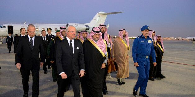 In this photo provided by the Saudi Press Agency, Sweden's King Carl XVI Gustaf is greeted by the Mayor of Riyadh, Prince Tur