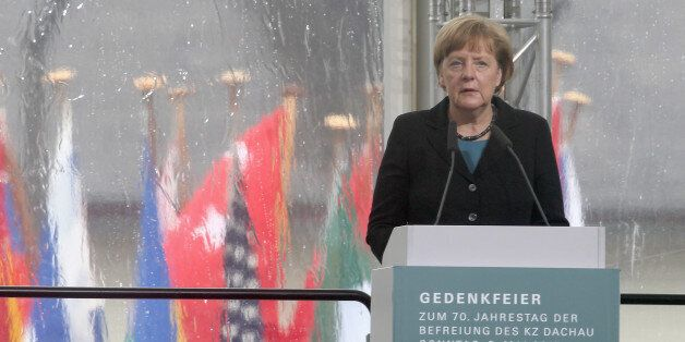 DACHAU, GERMANY - MAY 03:  German Chancellor Angela Merkel speaks at a ceremony to commemorate the 70th anniversary of the li